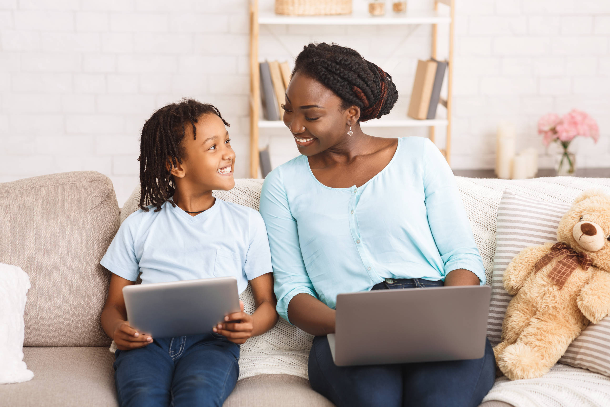 Black mom and daughter planning their dream trip