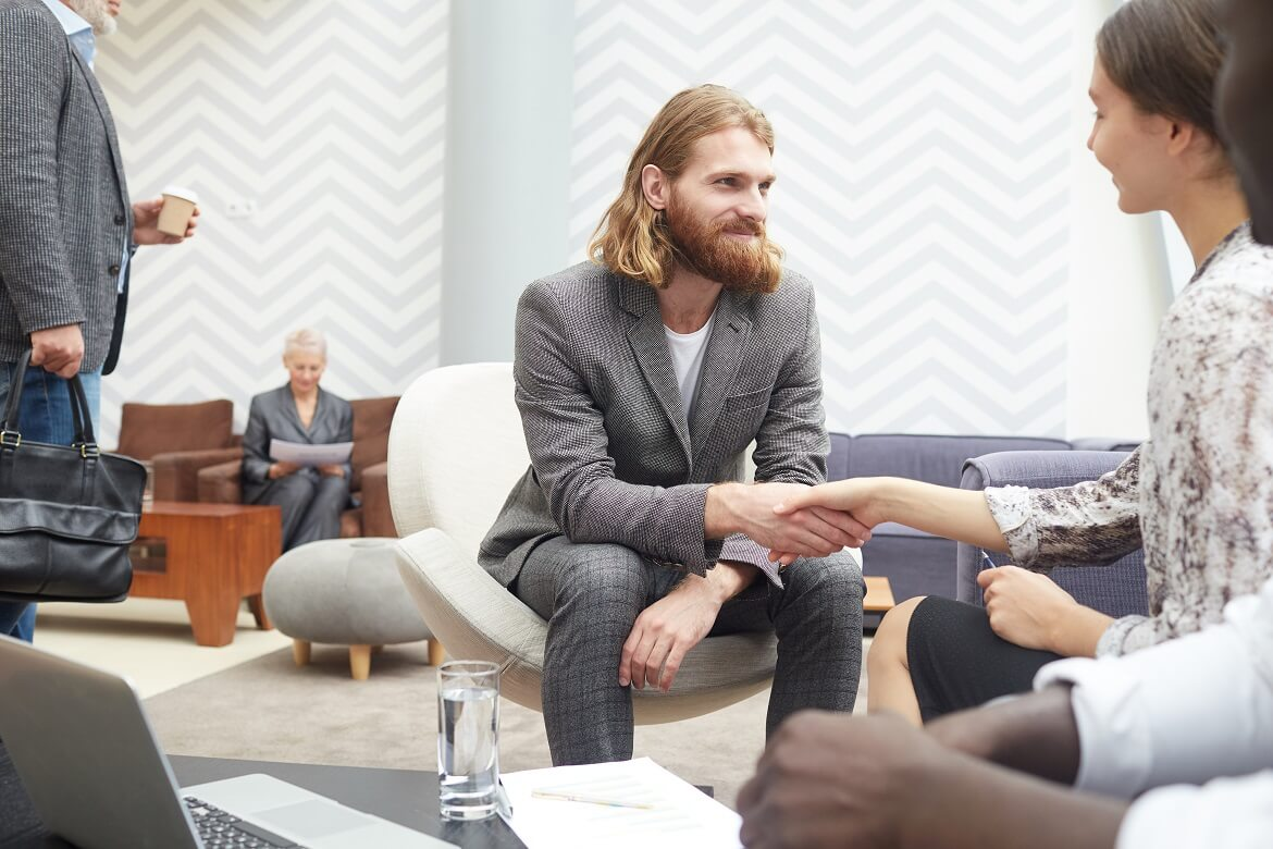businessman shaking hands with employer for an interview