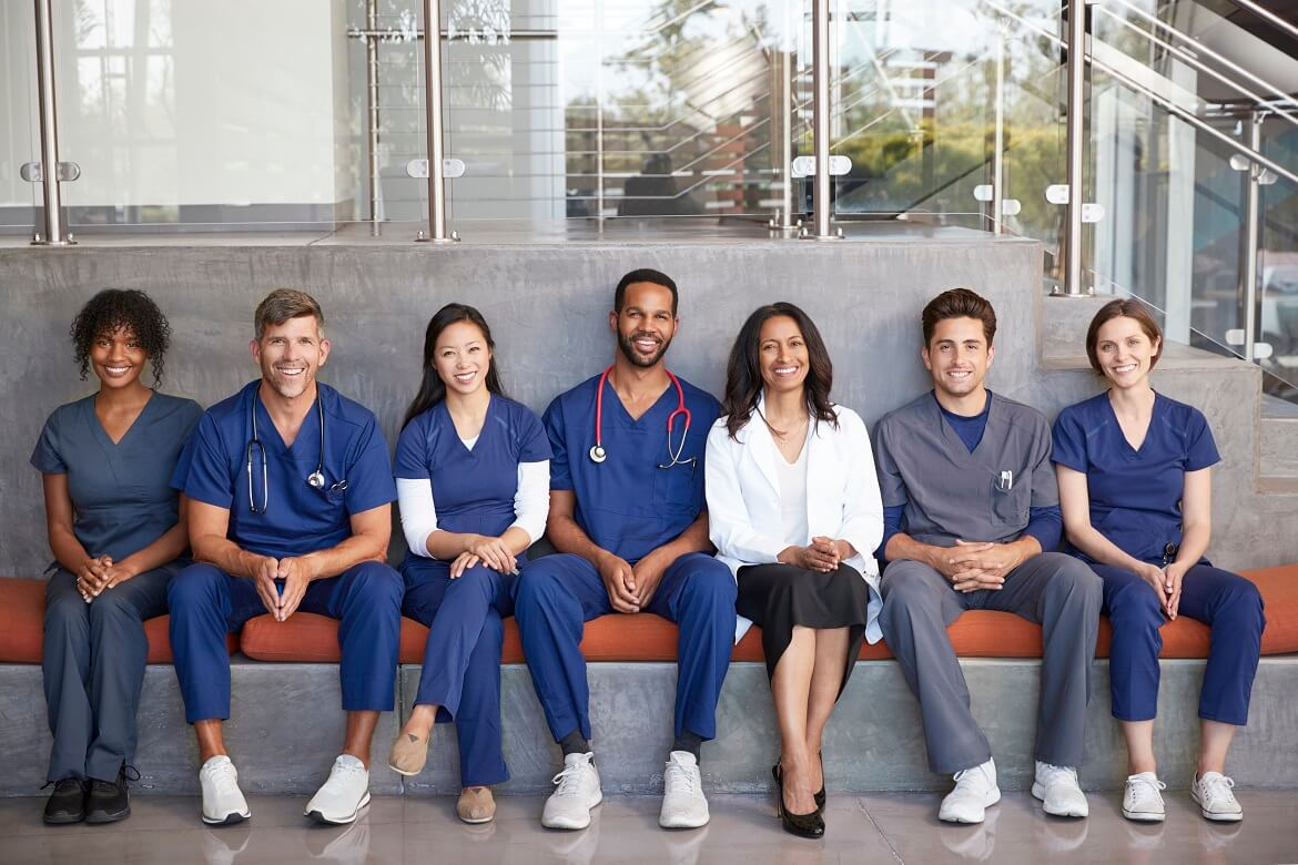 healthcare workers sitting together in a modern holl