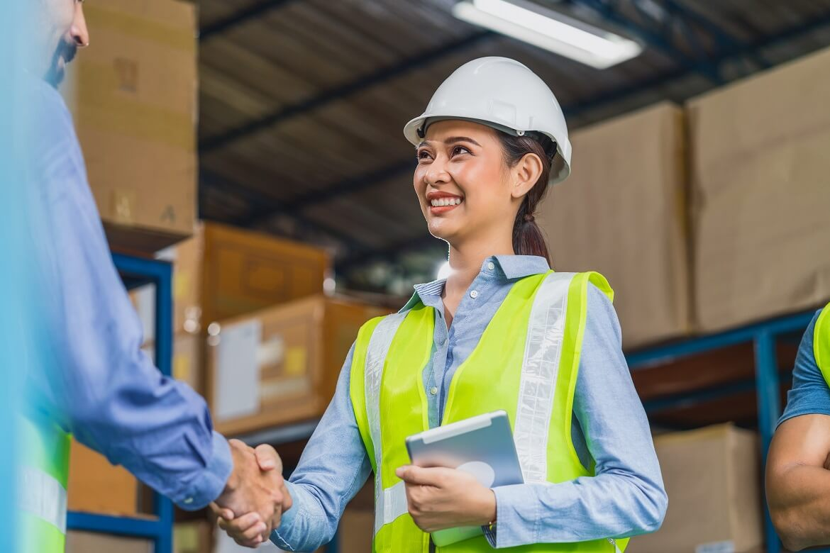 manager of warehouse worker hand shake with assist