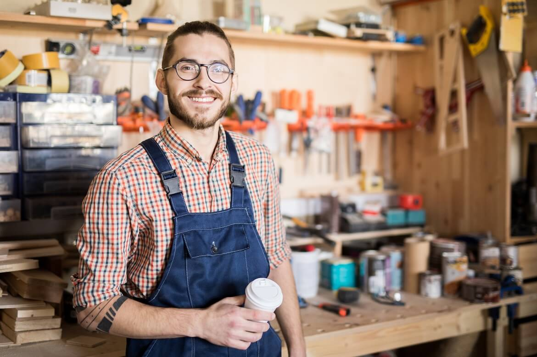 smiling male barista