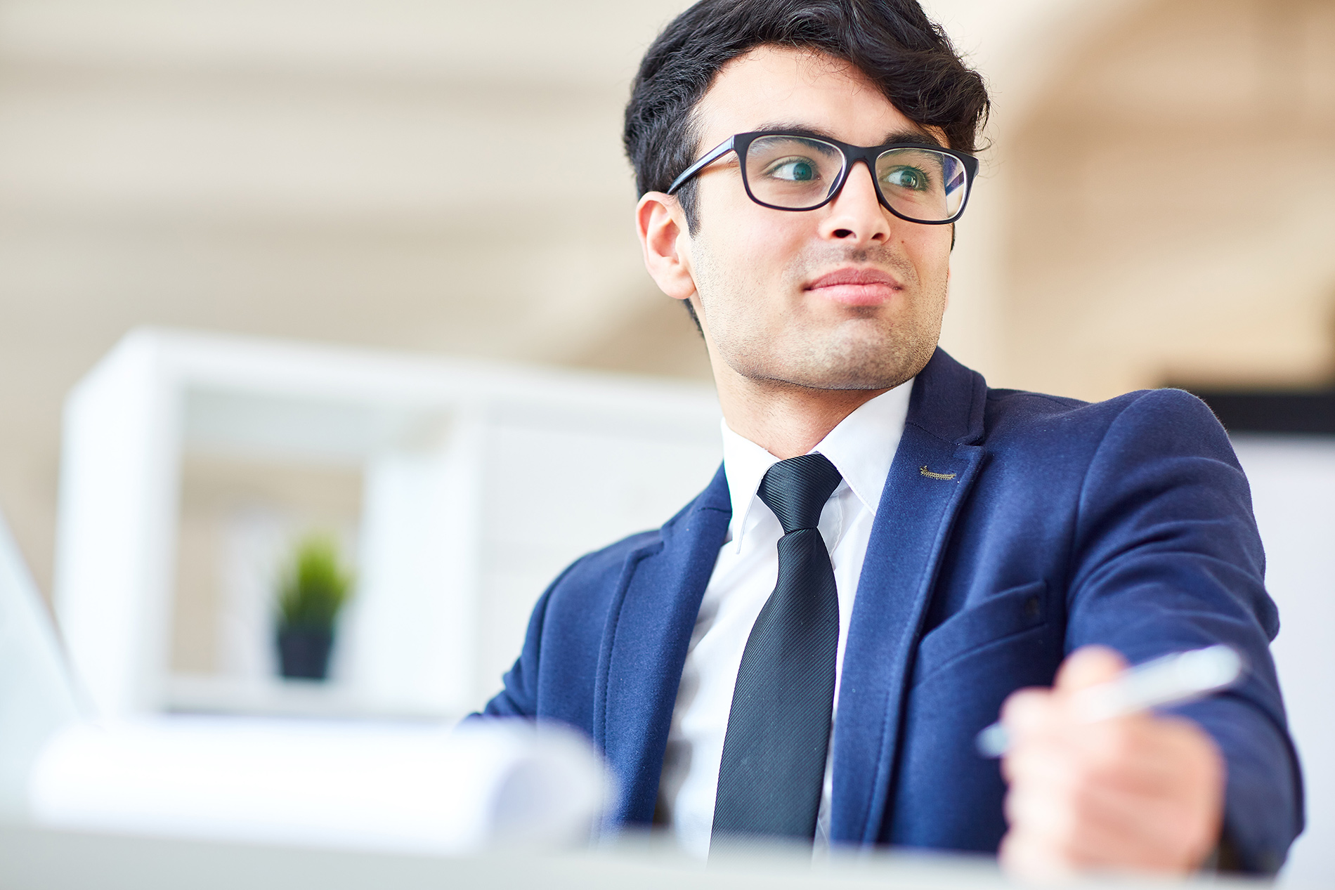 attentive male employee with glasses