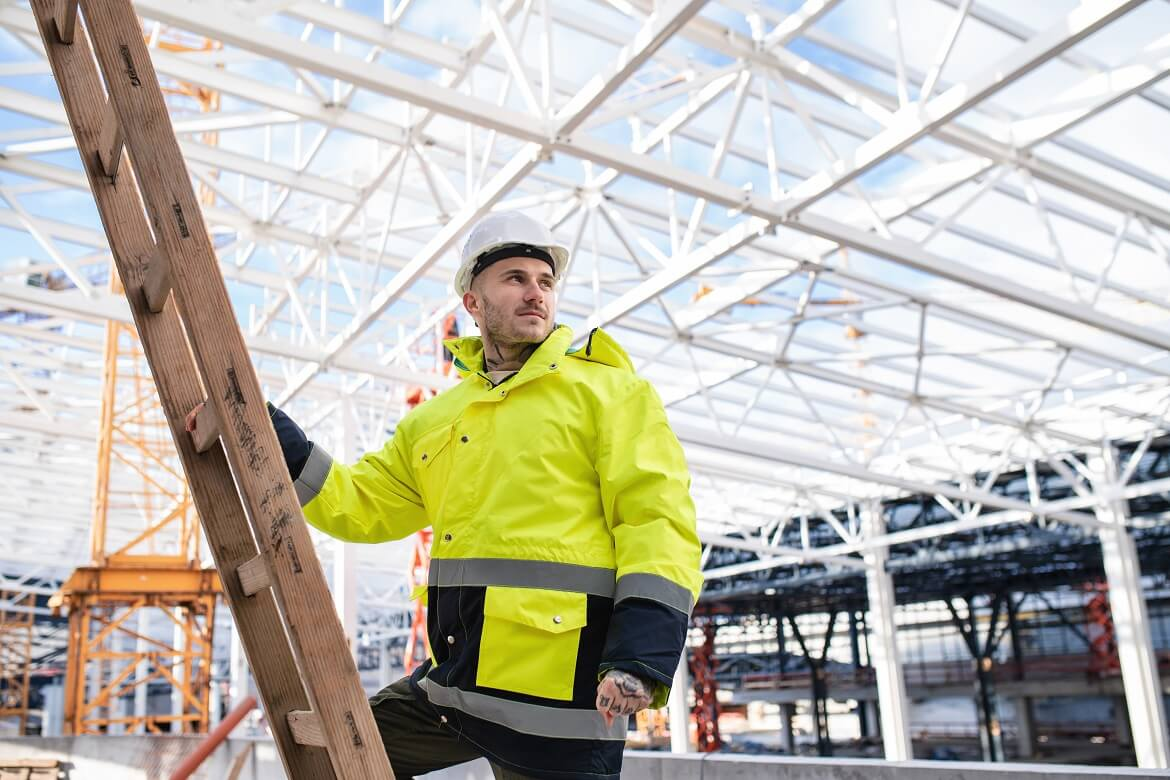 a male worker outdoors on construction site working