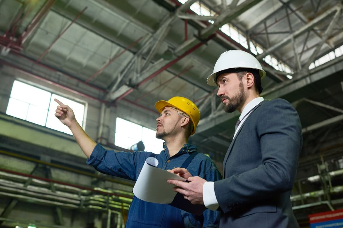 two male engineers at work in a warehouse setting