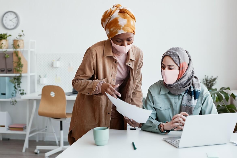 businesswomen wearing masks at work
