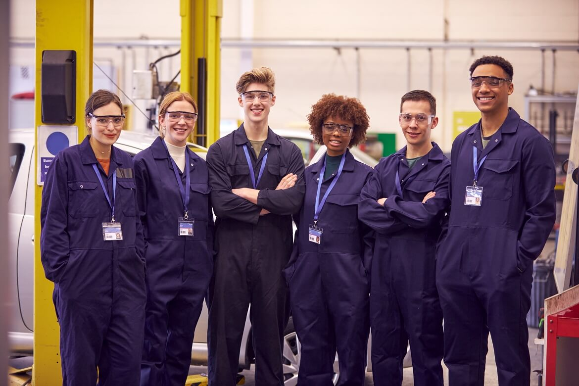 Portrait Of Students Studying For Auto Mechanic Apprenticeship At College