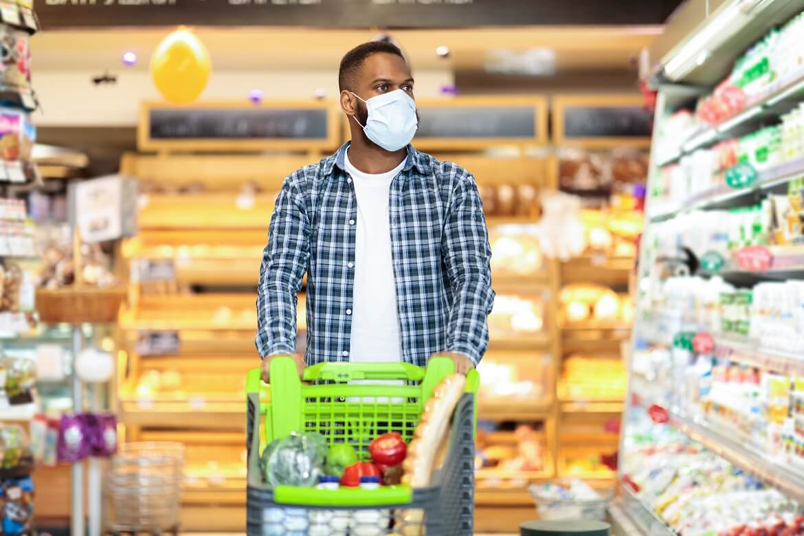 Black Man In Face Mask Shopping Groceries In Supermarket Store